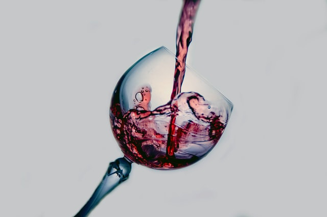 red wine poured into wine glass - healthy